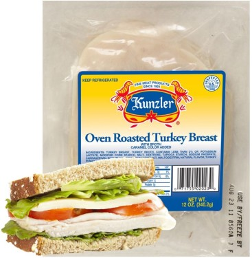 Oven Roasted Turkey Breast Package with a sandwich sitting in front