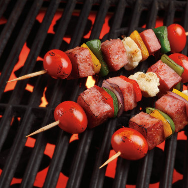 ham kabobs cooking on grill